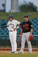 Steve Selsky #13 of the Bakersfield Blaze holds Matt Duffy #13 of the Lancaster JetHawks on first base during a game at The Hanger on July 2, 2013 in Adelanto, California. Lancaster defeated Bakersfield, 12-1. (Larry Goren/Four Seam Images)