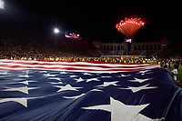 LOS ANGELES, CA - SEPTEMBER 11: Fireworks and American Flag during an September 11th remembrance and National Anthem before a game between University of Southern California and Stanford Football at Los Angeles Memorial Coliseum on September 11, 2021 in Los Angeles, California.