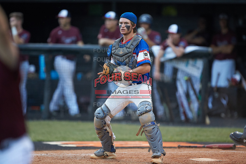 Mooresville Post 66 catcher Cole Robbins (18) on defense against Kannapolis Post 115 during an American Legion baseball game at Northwest Cabarrus High School on May 30, 2019 in Concord, North Carolina. Mooresville Post 66 defeated Kannapolis Post 115 4-3. (Brian Westerholt/Four Seam Images)