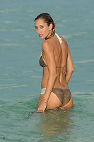 SMG_EXC_Lauren Stoner_GreenBikini_090811_13.JPG_EXCLUSIVE COVERAGE<br /> <br /> MIAMI BEACH, FL - SEPTEMBER 08:  (EXCLUSIVE COVERAGE) Apparently everything Kim Kardashian touches turns to gold. Meet her latest find model-turned reality star Lauren Stoner. The model is best known for appearing on E! Show The Spin Crowd (which is Produced by Kim kardashian who is rumored to have hand pick Lauren for the part). Lauren featured as an 'office hottie' for the Command PR firm, working alongside Jonathan Cheban and Simon Huck, doing public relations for celebrity events and endorsements in New York and LA.  Apparently Kardashian is not the only one to have an interest in the stunning 5foot 10inch model. Lauren Stoner was photographed earlier in the week with Transformer director Michael Bay at the beach.  All week rumors have been flying as to if this is director Michael bay's next find.  He catapulted Megan Fox and Rosie Huntington-Whiteley into superstardom, and speculation is that maybe Lauren is the next babe to appear in the highly successful Transformers series. Lauren is seen here looking super fit, tone and gorgeous in her Skippy bikini no wonder she got Michael Bays attention, she got our attention, that's for sure!. On September 8, 2011 in Miami Beach,  Florida  (Photo By Storms Media Group)<br /> <br /> People:   Lauren Stoner<br /> <br /> Must call if interested<br /> Michael Storms<br /> Storms Media Group Inc.<br /> 305-632-3400 - Cell<br /> 305-513-5783 - Fax<br /> MikeStorm@aol.com