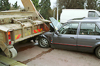 Road traffic accident involving a car and a skip lorry. The driver of the car tried to avoid heavy traffic by driving down a bus lane and dove straight into the back of the stationary heavy goods vehicle and was crushed underits rear wheels. The dashboard, windscreen, roof, bonnet and engine were completely destroyed. ..© SHOUT. THIS PICTURE MUST ONLY BE USED TO ILLUSTRATE THE EMERGENCY SERVICES IN A POSITIVE MANNER. CONTACT JOHN CALLAN. Exact date unknown.john@shoutpictures.com.www.shoutpictures.com.