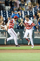 Louisville Cardinals outfielder Drew Campbell (1) celebrates driving in the winning run during the ninth inning of Game 10 of the NCAA College World Series against the Mississippi State Bulldogs on June 20, 2019 at TD Ameritrade Park in Omaha, Nebraska. Louisville defeated Mississippi State 4-3. (Andrew Woolley/Four Seam Images)