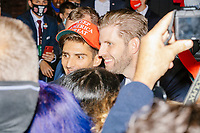 Eric Trump, son of US president Donald Trump, greets people and signs MAGA hats and Trump campaign signs after speaking during a Make America Great Again! campaign rally at the DoubleTree by Hilton Manchester Downtown in Manchester, New Hampshire, on Mon., Oct. 19, 2020.