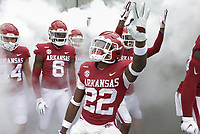 Arkansas players run out onto the field, Saturday, November 21, 2020 before a football game at Donald W. Reynolds Razorback Stadium in Fayetteville. Check out nwaonline.com/201122Daily/ for today's photo gallery. <br /> (NWA Democrat-Gazette/Charlie Kaijo)