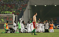 Hungary's Andras Debreceni (5) walks off of the pitch as the Ghana team participates in prayer after winning the FIFA Under 20 World Cup Semi-final match at the Cairo International Stadium in Cairo, Egypt, on October 13, 2009. Costa Rica won the match 1-2 in overtime play. Ghana won the match 3-2.