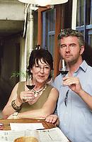 The owner Dany Bertuis and a guest. Wine bar les Enfants Rouges in Paris. Paris, France.