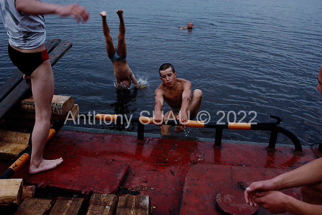 Sol'vychegodsk, Russia<br /> July, 1988<br /> <br /> Boys swim in the river where the village where the Stganov family began by the Balgovehchenck  Cathedral.