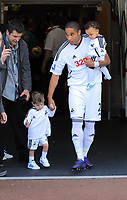 FAO SPORTS PICTURE DESK<br /> Pictured: Hari Kieft (L) coming out onto the pitch with Ashley Williams. Sunday, 13 May 2012<br /> Re: Premier League football, Swansea City FC v Liverpool FC at the Liberty Stadium, south Wales.