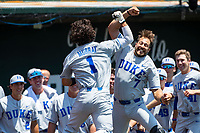 Duke Blue Devils shortstop Ethan Murray (1) celebrates with teammate Chris Dutra (7) during the game against the Wright State Raiders in NCAA Regional play on Robert M. Lindsay Field at Lindsey Nelson Stadium on June 5, 2021, in Knoxville, Tennessee. (Danny Parker/Four Seam Images)