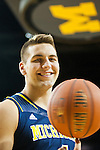 Michigan forward Mitch McGary poses for a portrait during the NCAA college basketball team's preseason media day, Thursday, Oct. 24, 2013, at Crisler Center in Ann Arbor, Mich. (AP Photo/Tony Ding)