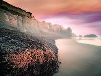 Low tide cliffs at Devil's Punchbowl State Natural Area. Oregon