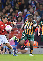 July 31, 2012..Japan's Saki Kumagai (4) and South Africa's Portia Modise (12) in action during Football match between JPN and RSA at the Millennium Stadium on day four of 2012 Olympic Games in Cardiff, United Kingdom..
