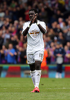 Pictured: Bafetimbi Gomis of Swansea thanks away supporters at the end of the game<br /> Re: Premier League match between Crystal Palace and Swansea City at Selhurst Park on May 24, 2015 in London, England, UK