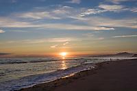Sunset coastal landscape along the Gulf of Alaska and the fairweather mountain range. mount fairweather on the right.