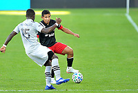 WASHINGTON, DC - NOVEMBER 8: Edison Flores #10 of D.C. United battles for the ball with Zachary Brault-Guillard #15 of Montreal Impact during a game between Montreal Impact and D.C. United at Audi Field on November 8, 2020 in Washington, DC.