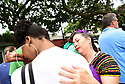 Members of the Baby Doll Sisterhood second line in memory of Baby Doll Tee Eva Perry, who died at 83 on June 7, in New Orleans, La. Monday, June 11, 2018. Tee Eva's great-niece Janai Steib is comforted by Anita Matamoros Oubre.