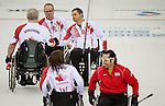 Sochi, RUSSIA - Mar 10 2014 -  Jim Armstrong, Mark Ideson, Dennis Thiessen and Ina Forrest celebrate defeating USA during Canada vs USA in Wheelchair Curling round robin play at the 2014 Paralympic Winter Games in Sochi, Russia.  (Photo: Matthew Murnaghan/Canadian Paralympic Committee)