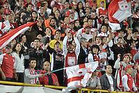BOGOTÁ -COLOMBIA, 19-06-2013. Hinchas de Santa Fe durante el encuentro contra Millonarios en los cuadrangulares finales F2 de la Liga Postobón 2013-1 jugado en el estadio el Campín de la ciudad de Bogotá./ Santa Fe fans during the match with Millonarios on the final quadrangular 2th date of Postobon  League 2013-1 at El Campin stadium in Bogotá city. Photo: VizzorImage/STR