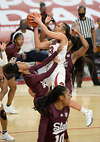 Arkansas guard Chelsea Dungee (center) takes a shot in the lane Thursday, Feb. 11, 2021, as she collides with Mississippi State guard Jamya Mingo-Young (left) during the first half of play in Bud Walton Arena. Visit nwaonline.com/210212Daily/ for today's photo gallery. <br /> (NWA Democrat-Gazette/Andy Shupe)
