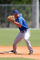 New York Mets infielder Justin Schafer #7 during a minor league spring training game against the Miami Marlins at the Roger Dean Sports Complex on March 28, 2012 in Jupiter, Florida.  (Mike Janes/Four Seam Images)