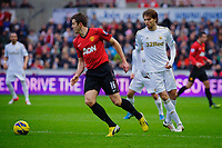 Sunday, 23 November 2012<br /> <br /> Pictured: Michael Carrick of Manchester United slips the ball past Michu of Swansea City<br /> <br /> Re: Barclays Premier League, Swansea City FC v Manchester United at the Liberty Stadium, south Wales.