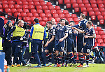 Paul Quinn celebrates as he scores goal no 2 for Ross County