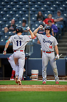 Reading Fightin Phils Austin Bossart (18) congratulates Luke Williams (11) after a home run during an Eastern League game against the Akron RubberDucks on June 4, 2019 at Canal Park in Akron, Ohio.  Akron defeated Reading 8-5.  (Mike Janes/Four Seam Images)