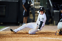Jackson Generals center fielder Evan Marzilli (45) slides home during a game against the Chattanooga Lookouts on April 29, 2017 at The Ballpark at Jackson in Jackson, Tennessee.  Jackson defeated Chattanooga 7-4.  (Mike Janes/Four Seam Images)