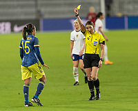 ORLANDO, FL - JANUARY 22: Referee Danielle Chesky shows a yellow card to Orianica Velasquez #15 during a game between Colombia and USWNT at Exploria stadium on January 22, 2021 in Orlando, Florida.