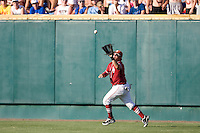 Oklahoma RF Cody Reine catches a fly ball in Game 10 of the NCAA Division One Men's College World Series on June 24th, 2010 at Johnny Rosenblatt Stadium in Omaha, Nebraska.  (Photo by Andrew Woolley / Four Seam Images)