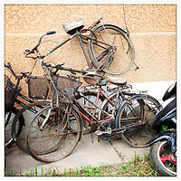 Bicycles stacked against a wall in a residential community in Beijing, China.