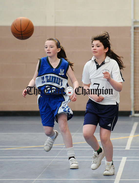 Michelle O Neill, Doora Barefield in action against Aine O Grady of Bridgetown  during the Comunity Games U-13 girls county basketball finals in Cratloe. Photograph by John Kelly.