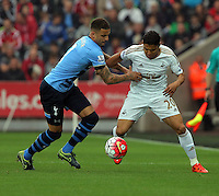 (L-R) Kyle Walker of Tottenham Hotspur closely marking Jefferson Montero of Swansea during the Barclays Premier League match between Swansea City and Tottenham Hotspur played at The Liberty Stadium, Swansea on October 4th 2015