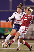 """USA's Julie Foudy goes toe to toe with Anne Dot Eggers of Denmark. The US Women's National Team tied the Denmark Women's National Team 1 to 1 during game 8 of the 10 game the """"Fan Celebration Tour"""" at Giant's Stadium, East Rutherford, NJ, on Wednesday, November 3, 2004.."""