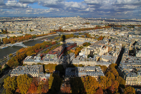 France, Paris.  Location Scout. <br /> I kept looking behind me to see if the sun might come out. It finally did and I quickly photographed from several preselected vantage points. Shadow of the Eiffel Tower, seen from the Eiffel Tower in autumn.