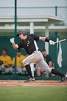 Pittsburgh Pirates Lucas Tancas (5) follows through on a swing during an Instructional League intrasquad black and gold game on October 3, 2017 at Pirate City in Bradenton, Florida.  (Mike Janes/Four Seam Images)