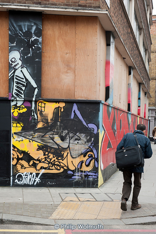 Mural in Shoreditch, London, a run-down commercial district  also known as Silicon Roundabout, which is undergoing gentrification as it becomes a centre for web-based companies and IT start-ups.
