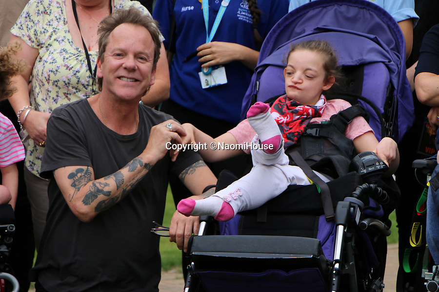BNPS.co.uk (01202 558833)<br /> Pic:  NaomiHouse/BNPS<br /> <br /> Hollywood star Kiefer Sutherland made a surprise visit to a hospice - after getting a video message on social media inviting him to drop by.<br /> <br /> The actor, who played Jack Bauer in 24 and has also starred in Designated Survivor, met residents at Naomi House & Jacksplace in Winchester, Hants.<br /> <br /> He had been due to perform at a local festival later in the day but was able to squeeze in the heartwarming visit.