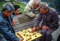 San Francisco, California, Chinatown. Chinese Men Playing Checkers in Portsmouth Square.