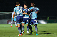 Adebayo Akinfenwa of Wycombe Wanderers (right) congratulates Nick Freeman of Wycombe Wanderers (22) on scoring his team's 3rd goal to make it 3-0 during the The Checkatrade Trophy match between Wycombe Wanderers and West Ham United U21 at Adams Park, High Wycombe, England on 4 October 2016. Photo by David Horn.