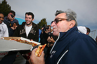 "State College, PA -- 10/25/2007 -- Penn State freshman engineering student Sean Burdette, from Spring Grove, PA, shares a slice of pizza with football coach Joe Paterno on Thursday morning.  Penn State students are camping outside of Beaver Stadium in hopes of being near the front of the student section for the game against Ohio State this Saturday.  The gathering of tents outside of the student entrance to the stadium has been dubbed ""Paternoville"" and received a visit from its namesake, Joe Paterno, and his wife, Sue, this morning.  The Paterno's delivered pizza to the students and thanked them for their support of the football team...Photo:  Joe Rokita / JoeRokita.com"