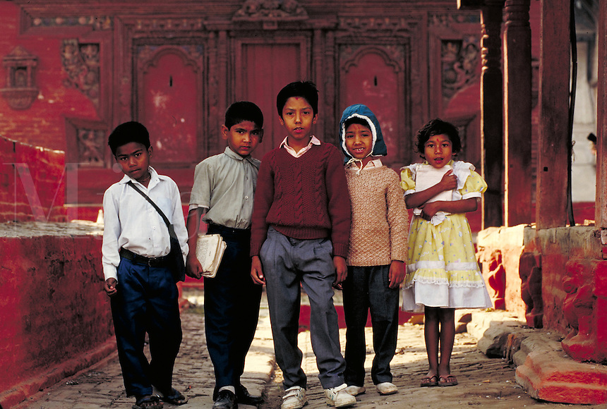 Ankit Agarwal and 4 friends stand in front of Jaganath Temple. Ankit Agarwal (center). Kathmandu, Nepal.
