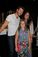 "Days of Our Lives Eric Martsolf ""Brady Black"" poses with fans Bella (C) and mom Elise Garbeck while Eric appears at the 12th Annual Comcast Women's Expo on September 7 (also 6th), 2014 at the Connecticut Convention Center, Hartford, CT. He signed photos, posed with fans, walked the runway with models from Kathy Faber Designs Fashion Show, and broke some boards at Villari's Martial Arts Centers booth with Maggie and Ryan Farley.  (Photo by Sue Coflin/Max Photos)"