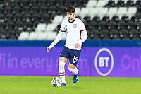 SWANSEA, WALES - NOVEMBER 12: Johnny Cardoso #16 of the United States runs with the ball during a game between Wales and USMNT at Liberty Stadium on November 12, 2020 in Swansea, Wales.