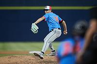 Guerreros de Fayetteville relief pitcher Shea Barry (14) in action against the Rapidos de Kannapolis at Atrium Health Ballpark on June 24, 2021 in Kannapolis, North Carolina. (Brian Westerholt/Four Seam Images)