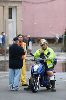 MAMARONECK, NY - AUGUST 28: Second Assistant Chief Craig Casterella, of the Mamaroneck Fire Department, sits on a motorcycle ready to assist with flooding on Mamaroneck Avenue in the Village of Mamaroneck, New York on Sunday August 28, 2011 in the aftermath of Hurricane Irene.