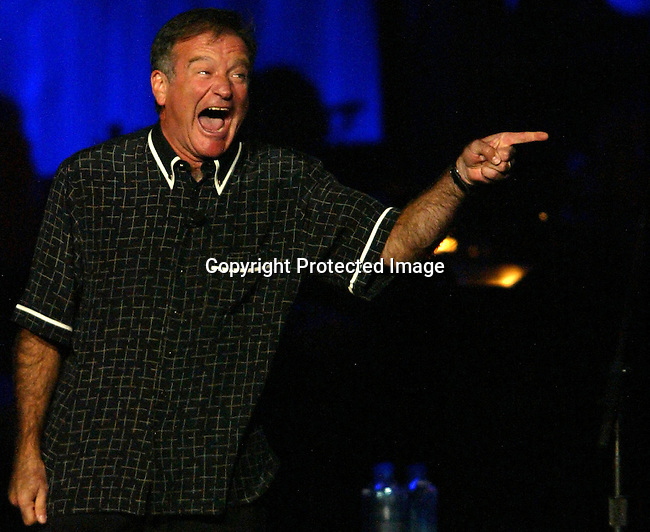 10/2/04,LAS VEGAS,NEVADA --- Robin Williams  performs at the Andre Agassi 9th Annual Grand Slam For Children concert fundraiser, a charity event featuring a superstar line-up of entertainers to benefit the Andre Agassi Charitable Foundation. --- Chris Farina  copyright 2004