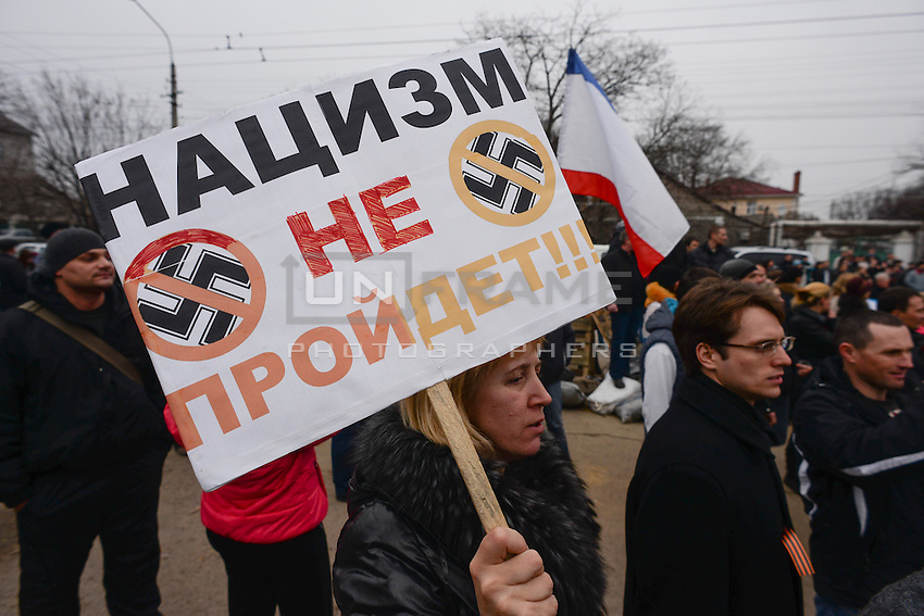 """pro-russian demonstrations in Simferopol. The banner reads: """"Nazism shall not pass"""". Crimea, Ukraine"""