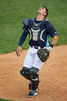 Wilmington Blue Rocks catcher Nathan Esposito (16) tracks a foul ball popup during the second game of a doubleheader against the Frederick Keys on May 14, 2017 at Daniel S. Frawley Stadium in Wilmington, Delaware.  Wilmington defeated Frederick 3-1.  (Mike Janes/Four Seam Images)