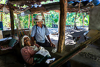 "November 10, 2014. ""Water it´s the real thing""<br /> Ernesto Montes with his neighbour, Santos Rodriguez, in his house in Nejapa (El Salvador). He has the illnes of Chikungunya and he doesn' t have drinking water at home. The people of Nejapa in El Salvador, have no drinking water because the Coca -Cola company overexploited the aquifer in the area, the most important source of water in this Central American country. This means that the population has to walk for hours to get water from wells and rivers. The problem is that these rivers and wells are contaminated by discharges that makes Coca- Cola and other factories that are installed in the area. The problem can increase: Coca Cola company has expansion plans, something that communities and NGOs want to stop. To make a liter of Coca Cola are needed 2,4 liters of water. ©Calamar2/ Pedro ARMESTRE"